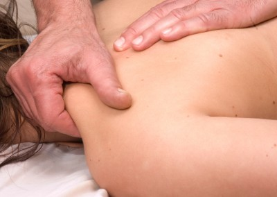 Woman having deep tissue massage